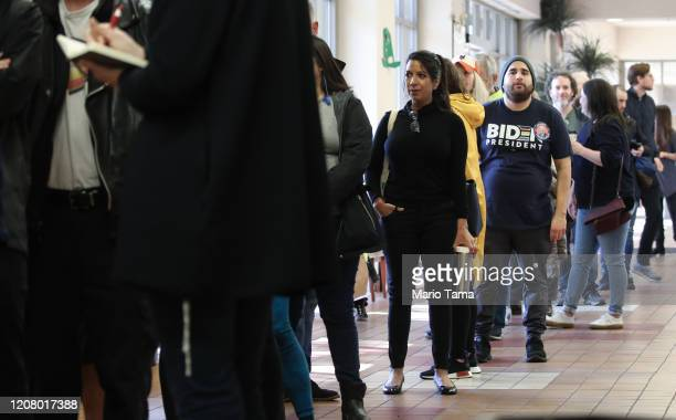 People line up to register to caucus at a Democratic presidential caucus site at East Las Vegas Community Center on February 22 2020 in Las Vegas...