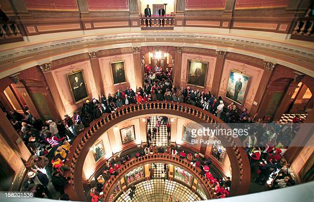 People line up to try to enter the House Chamber where a vote is scheduled to take place on RighttoWork legislation at the Michigan State Capitol...