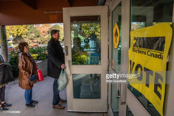 People line up to vote at a polling station at Trinity Community Rec Center for Canada's 43rd general election October 21 2019 in Toronto Ontario...