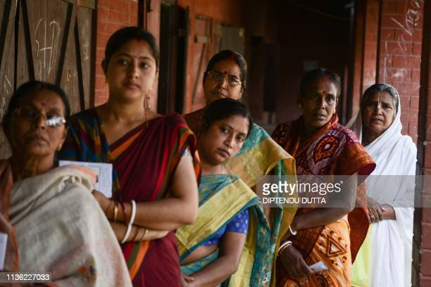 People line up to vote at a polling station during India's general election in Cooch Behar West Bengal on April 11 2019 India's mammoth sixweek...