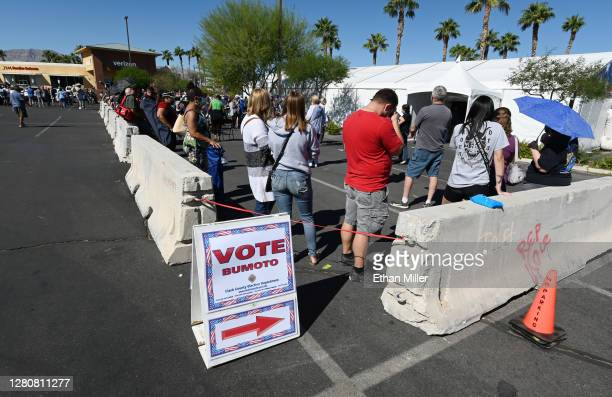People line up to vote at a shopping center on the first day of in-person early voting on October 17, 2020 in Las Vegas, Nevada. Early voting for the...