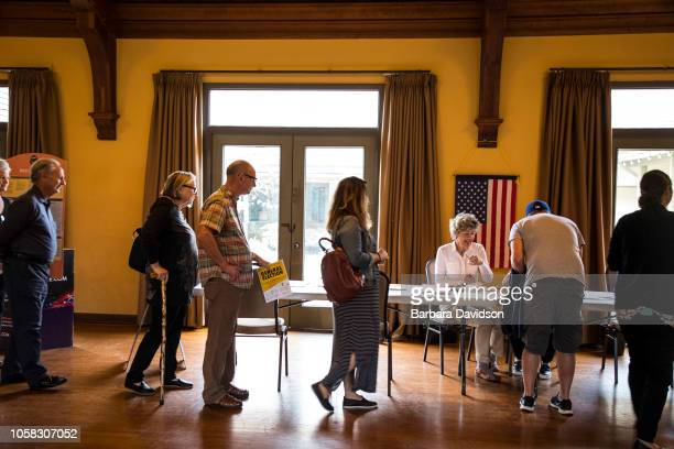 People line up to vote at the Congressional Church on election day November 6 2018 in Laguna Beach California Voters head to the polls across the...