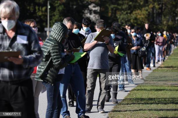 People line up to vote at the Gwinnett County Fairgrounds on October 30, 2020 in Lawrenceville, Georgia. Hundreds of people lined up for about an...