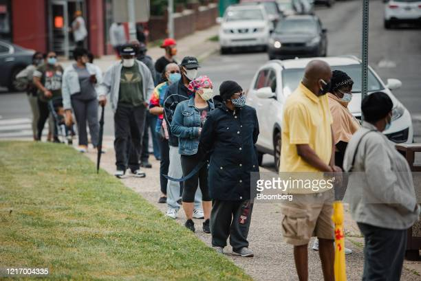 People line up to vote at the Masjidullah Mosque in Philadelphia, Pennsylvania, U.S., on Tuesday, June 2, 2020. Amid the coronavirus pandemic,...