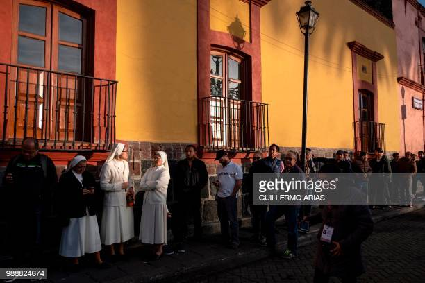 People line up to vote during the presidential election at a polling station in Xochimilco Mexico City on July 1 2018 Fed up with corruption and...