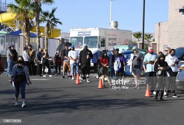 People line up to vote next to a food truck giving out free food to voters at Desert Breeze Community Center on November 3, 2020 in Las Vegas,...