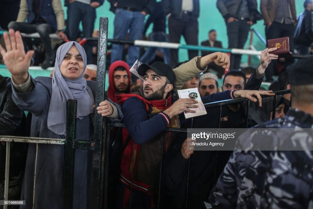 People line up with their passports to cross to Egypt following the opening of Rafah border gate in Khan Yunis, Gaza on February 21, 2018. Egypt temporarily opened Rafah crossing point on the borders with the Gaza Strip in both directions for four days.