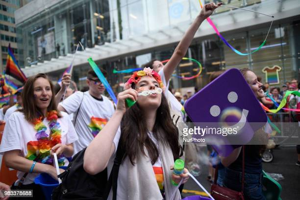 People lined the sidewalks along Yonge Street to witness the Annual Pride Parade on a rainy and wet day in Toronto Canada on June 24 2018