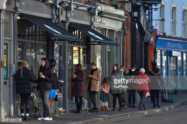 People lined up outside Thyme Out, a gourmet grocery store in Dalkey, a suburb of Dublin, during Level 5 Covid-19 lockdown. On Monday, February 22 in...