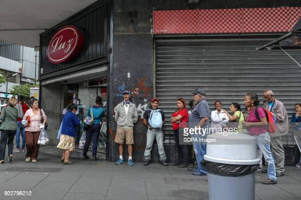 People lined up to buy food at LUZ store The crisis continues to worsen in Venezuela and many people must stand in line to obtain regulated products...