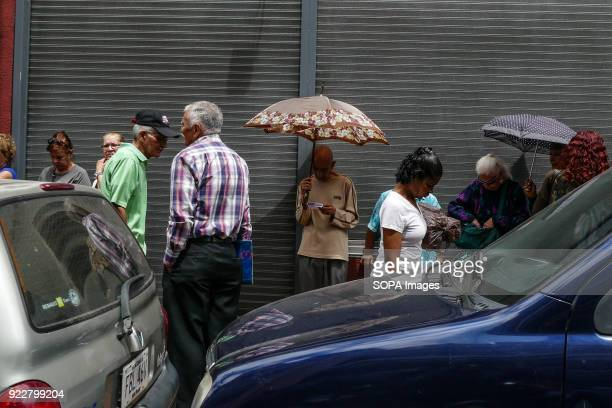 People lined up to buy food The crisis continues to worsen in Venezuela and many people must stand in line to obtain regulated products because the...