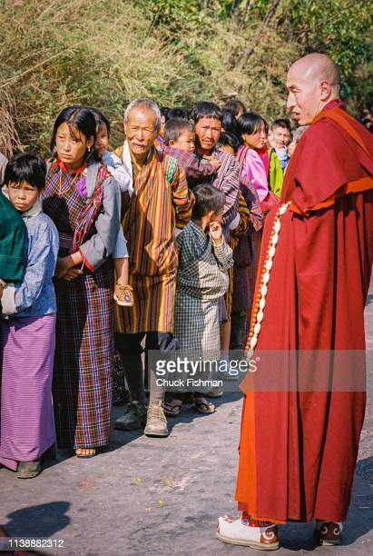 People lined up waiting to be blessed by Buddhist Bhutanese spiritual leader Trulku Jigme Chode who will bless them from the car taking him along the...
