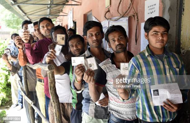 People lineup for casting his vote for the Rajouri Garden Assembly byelection on April 9 2017 in New Delhi India Voting is underway at the Rajouri...