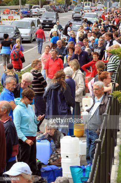 People lineup for water at Redcliffs School after it was rocked by a 63 magnatude earthquake on February 24 2011 in Christchurch New Zealand The 63...