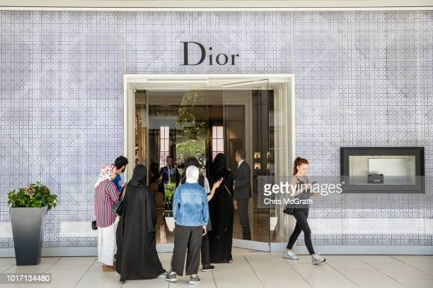 People lineup outside a Dior store to take advantage of low prices due to the exchange rate at the Zorlu luxury shopping mall on August 15 2018 in...