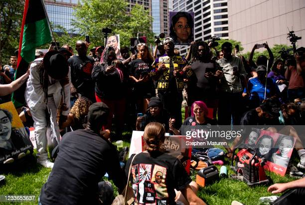 People link arms outside the Hennepin County Government Center as Judge Peter Cahill announces the sentencing of Derek Chauvin on June 25, 2021 in...