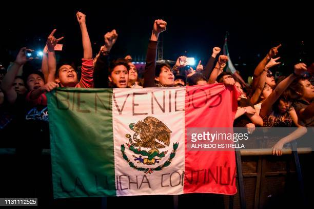 People listen and cheer Spanish band SkaP performs during the first day of the 'Vive Latino' music festival in Mexico City on March 16 2019