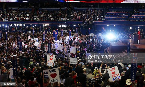 People listen as Ann Romney wife of Republican presidential candidate former Massachusetts Gov Mitt Romney speaks on stage during the Republican...