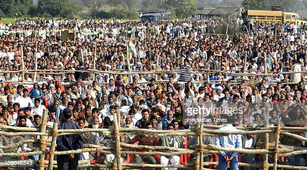 People listen as Congress General Secretary Rahul Gandhi addresses the crowd during an election rally on February 1 2012 in Faizabad India Gandhi hit...