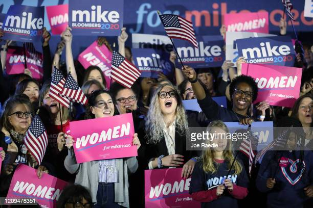People listen as Democratic presidential candidate former New York City mayor Mike Bloomberg speaks during a rally held at the Hilton McLean Tysons...