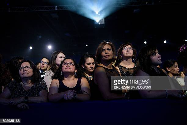 TOPSHOT People listen as Democratic presidential nominee Hillary Clinton speaks during the Congressional Hispanic Caucus Gala September 15 2016 in...