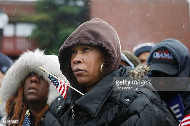 People listen as Democratic presidential nominee US Sen Barack Obama speaks in the rain during a campaign rally at Widener University Main Quad...