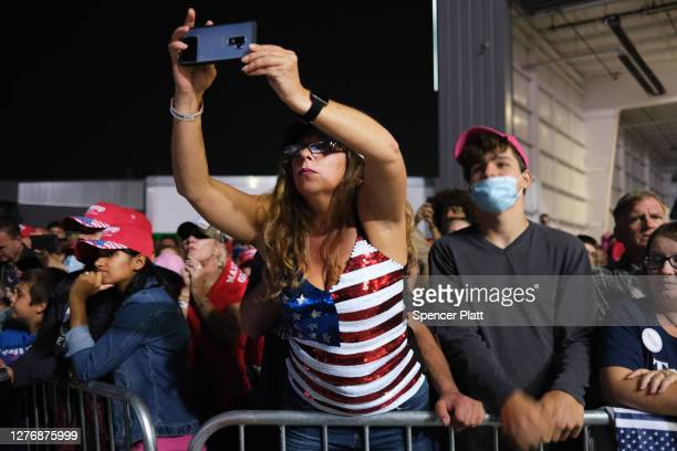 People listen as President Donald Trump speaks at a rally at Harrisburg International Airport on September 26 2020 in Middletown Pennsylvania Trump...