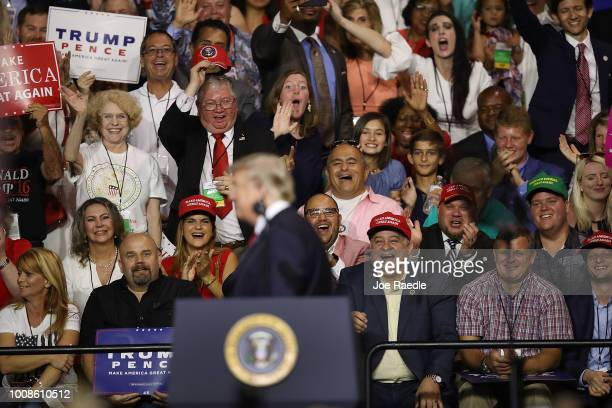 People listen as President Donald Trump speaks during his Make America Great Again Rally at the Florida State Fair Grounds Expo Hall on July 31 2018...