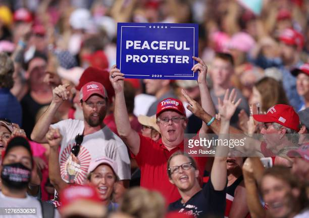 People listen as President Donald Trump speaks during his 'The Great American Comeback Rally' at Cecil Airport on September 24 2020 in Jacksonville...