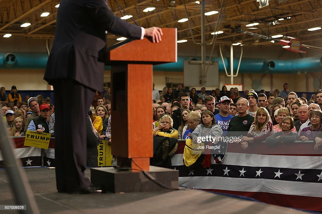 People listen as Republican presidential candidate Donald Trump speaks during a campaign event at the University of Iowa on January 26, 2016 in Iowa City, Iowa. Trump continues his quest to become the Republican presidential nominee.