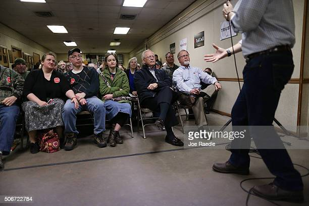 People listen as Republican presidential candidate Sen Ted Cruz speaks during a campaign event at the Jackson Fairgrounds on January 25 2016 in...
