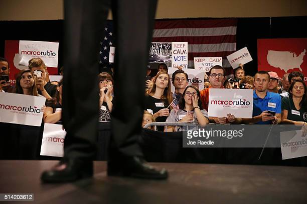 People listen as Republican presidential candidate US Sen Marco Rubio speaks during a campaign rally at theTampa Convention Center on March 7 2016 in...
