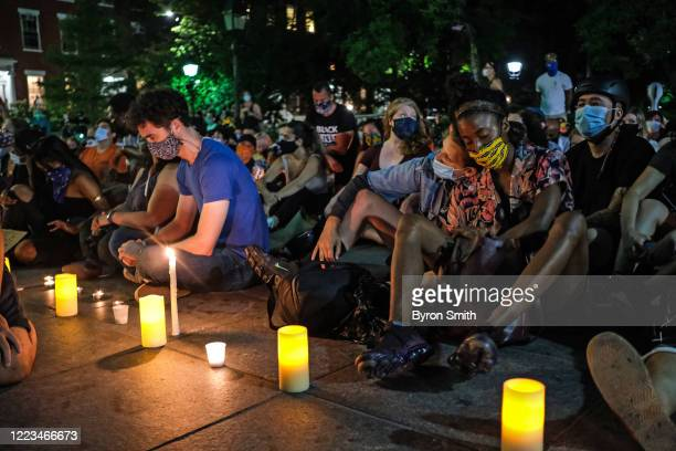 People listen as string players perform during a violin vigil for Elijah McClain in Washington Square Park on June 29 2020 in New York City McClain...