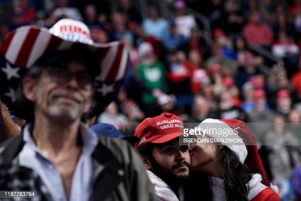 People listen as US President Donald Trump speaks during a Keep America Great rally at the Giant Center in Hershey, Pennsylvania on December 10, 2019.