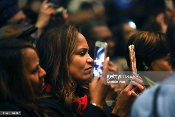 People listen as US Rep Alexandria OcasioCortez speaks at the National Action Network's annual convention on April 5 2019 in New York City Founded by...