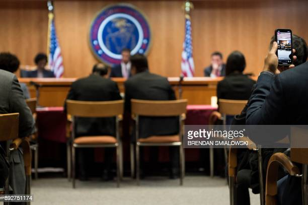 People listen during a hearing at the Federal Communications Commission for a vote to repeal Net Neutrality protections on December 14 2017 in...