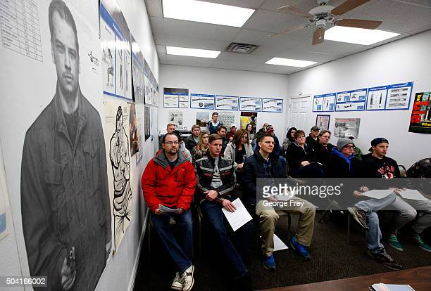 People listen during a packed class to obtain the Utah concealed gun carry permit at Range Master of Utah on January 9 2016 in Springville Utah Utahs...