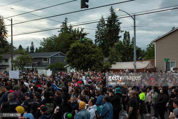 People listen during a vigil for Manuel Ellis a black man whose March death while in Tacoma Police custody was recently found to be a homicide...