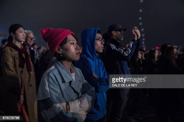 People listen to a band during the Clockenflap music festival in Hong Kong on November 19 2017 / AFP PHOTO / DALE DE LA REY