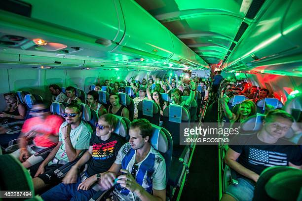 People listen to a DJ performing on in a grounded plane on July 16 2014 ahead of the Tomorrowland music festival at De Schorre in Boom starting on...