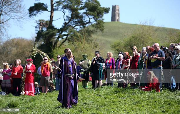 People listen to a speaker as they take part in a Beltane May Day celebration below Glastonbury Tor on May 1 2013 in Glastonbury England Although...