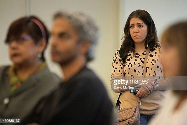 People listen to a speaker at the free Affordable Care Act Enrollment Fair at Pasadena City College on November 19, 2013 in Pasadena, California. The...