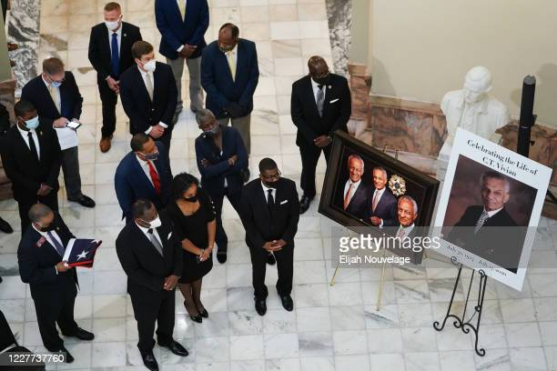 People listen to a speaker during a short service for civil rights leader C.T. Vivian as he lies in state in the Georgia Capitol building on July 22,...
