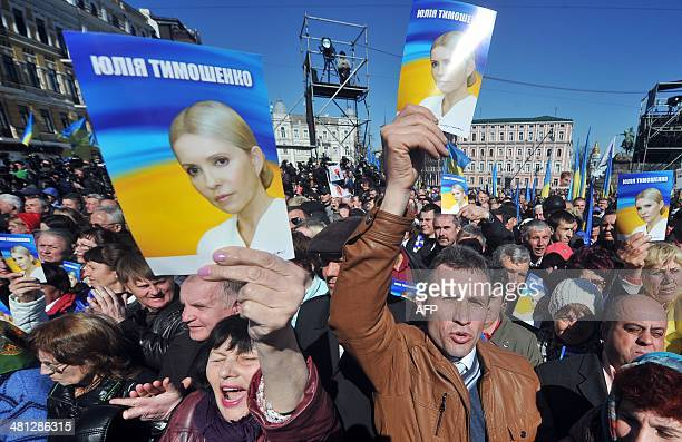 People listen to a speech by former Ukrainian prime minister and opposition leader Yulia Tymoshenko during a convention in Kiev on March 29 2014...