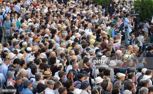 People listen to a stump speech given by a candidate in Tokyo on Oct 10 the first day of official campaigning for the Oct 22 House of Representatives...