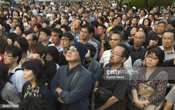 People listen to a stump speech given by a party leader in Nagoya central Japan on Oct 9 prior to the Oct 22 House of Representatives election ==Kyodo