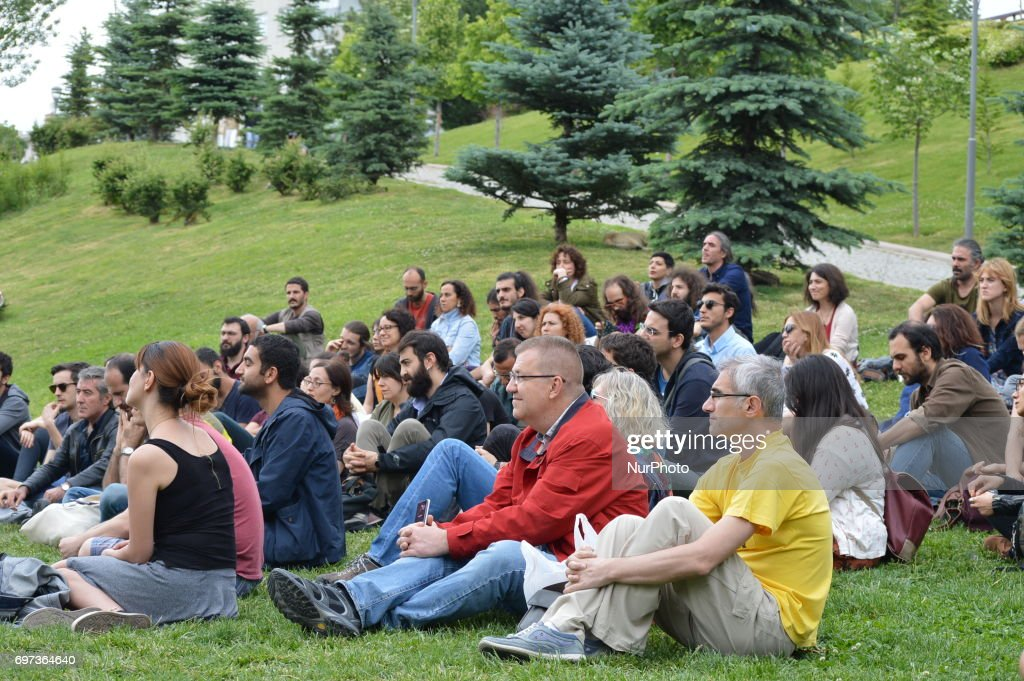 People listen to an outdoor lecture on 'Post-truth' at the park in Ankara, Turkey on June 18, 2017.