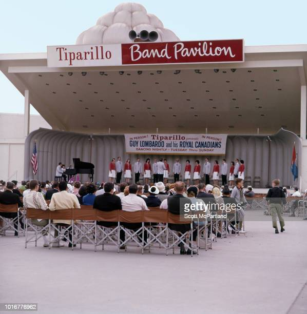 People listen to an unidentified vocal group at the Tiparillo Band Pavilion in Flushing Meadows Park at the World's Fair in Queens New York New York...