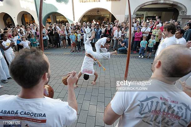 People listen to Brazilian music on June 21 2013 in Strasbourg eastern France as part of the 32th edition of the annual music event 'La Fete de la...