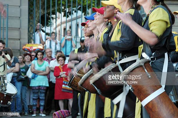 People listen to Brazilian music on June 21 2013 in Strasbourg eastern France during the 32nd edition of the annual music event 'La Fete de la...
